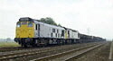 Class 25 Bo-Bo diesel locomotives nos. 25037 & 25104 with a freight train south of Loughborough
